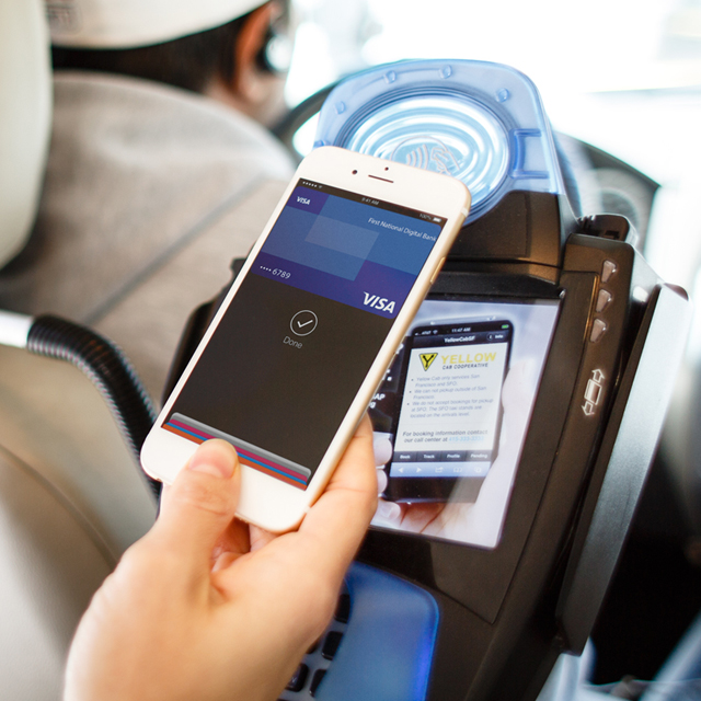 Person using Visa payWave to pay for a taxi