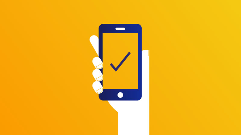 Illustration showing hand holding phone with tick mark on screen